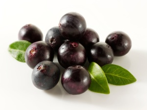 Acai Berries anti oxident fruit  loose on a white background ready to cut out.